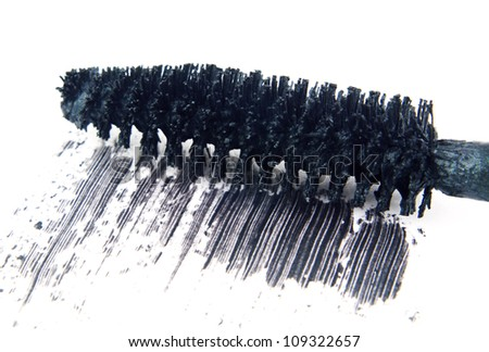 Close up macro of black mascara makeup brush wand with smear isolated on white background with copy space. - stock photo