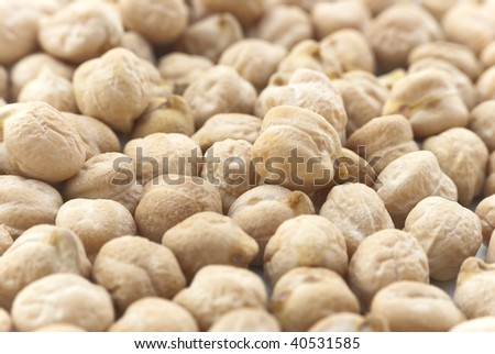 Close-up (macro) of chickpeas (garbanzo beans) filling whole frame. - stock photo