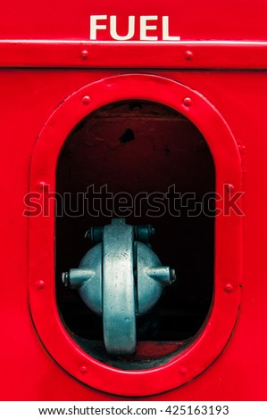 Close up, macro photo of Fuel vintage car or red bus, classic bus with colorful - stock photo