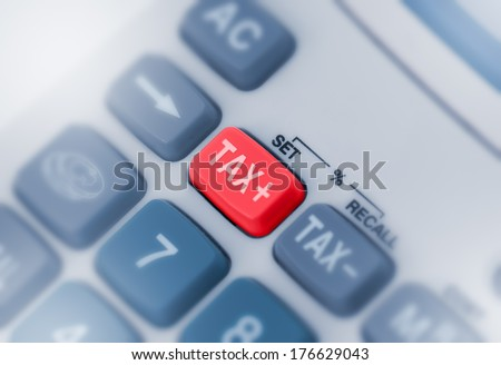 Close up macro shot of calculator with tax button - stock photo