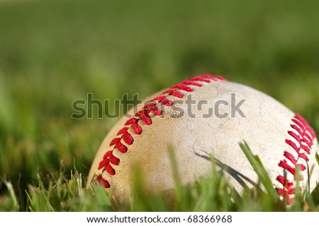 Close up macro view of the seams on a used baseball - stock photo