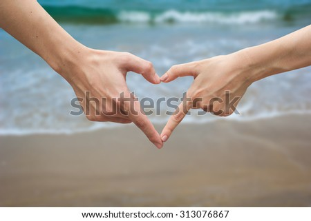 close up male and female hands making heart on blurred vintage colors backgrounds . passion in love concept ,soft focused.picture use for work about decorate,design,wedding,card,valentine and etc. - stock photo