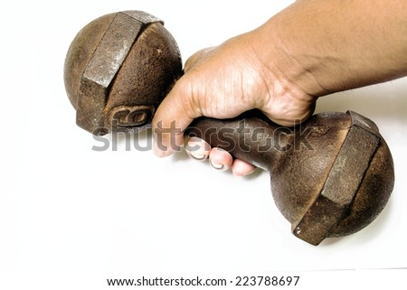 close up male hand is holding metal barbell isolated on white - stock photo
