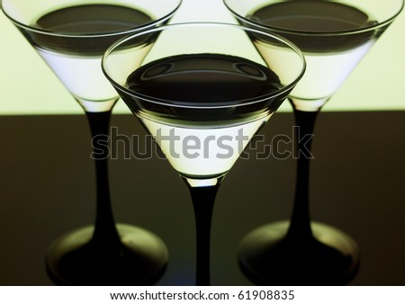 Close up martini glass for cocktails on a yellow background - stock photo