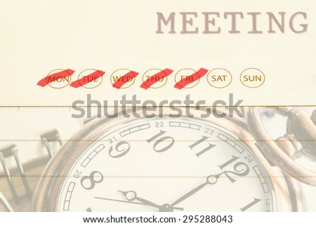 Close up meeting date on diary with pocket watch. - stock photo