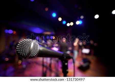Close up microphone on music stage - horizontal - stock photo