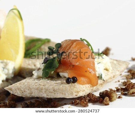 Close up mini appetizer with bread scone and smoked salmon - stock photo