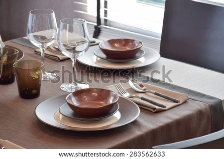 Close up modern classic dining set on wooden dining table - stock photo
