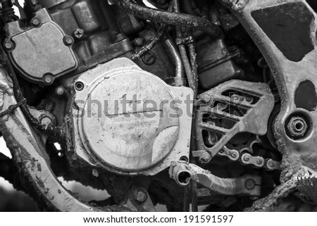 Close-up monochrome fragment of sport motocross bike engine - stock photo