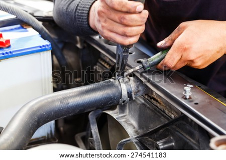 Close up motor vehicle mechanic repairing car radiator, automotive maintenance service - stock photo