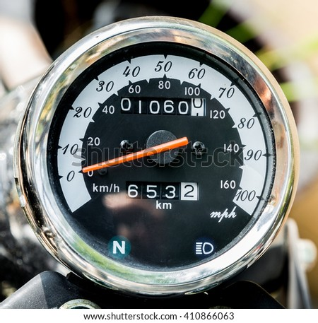 close-up motorcycle speedometer with chrome ring - stock photo
