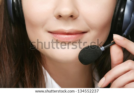 Close-up (mouth) of a friendly female call center operator - stock photo