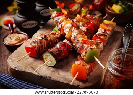 Close up Mouth Watering Gourmet Barbecue on Wooden Chopping Board at the Table. - stock photo