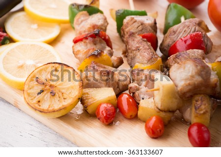 Close up Mouth Watering Gourmet Barbecue on Wooden Chopping Board at the Table - stock photo