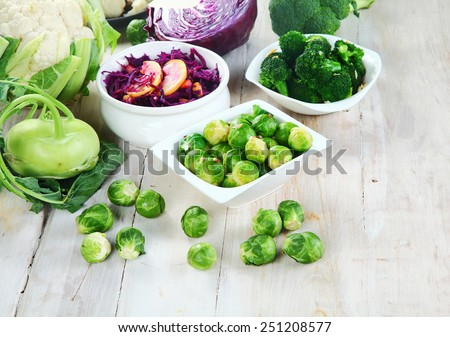Close up Newly Harvested Healthy Farm Vegetables for Recipe Ingredients on Top of Wooden Table - stock photo