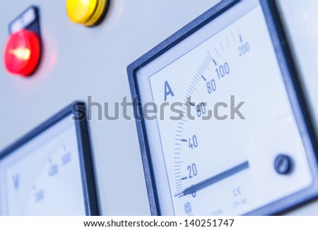 Close up number voltmeter on outside wall - stock photo