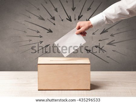 close up of a ballot box and casting vote on grungy background - stock photo