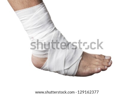 Close-up of a bandage wrapped on injured ankle isolated over white. - stock photo