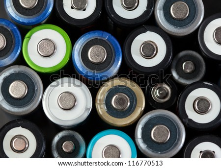 Close up of a batch od batteries, top view - stock photo