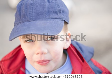 close up of a beautiful boy with blue eyes, outdoor portrait - stock photo