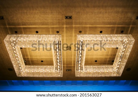 Close-up of a beautiful crystal chandelier - stock photo