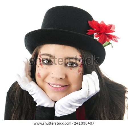 Close-up of a beautiful teen girl in black top hat and white gloves happily resting her heart-decorated face in her hands.  On a white background. - stock photo