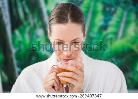 Close up of a beautiful young woman drinking tea over white background - stock photo