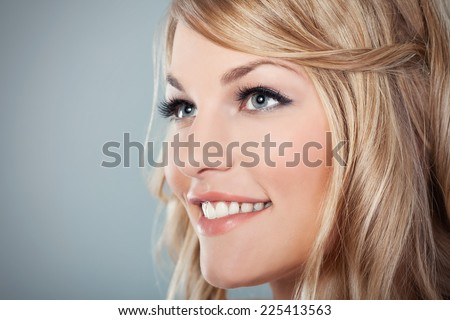 Close-up of a beautiful young woman looking away - stock photo