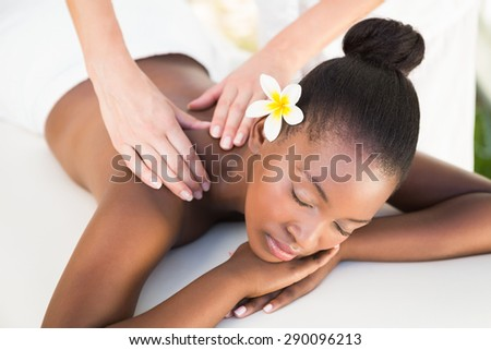 Close up of a beautiful young woman on massage table outdoors - stock photo