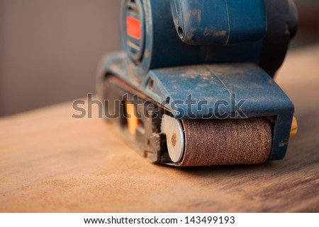 Close up of a belt sander - stock photo