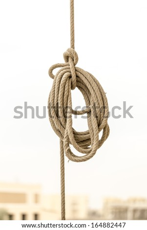 Close up of a big rope knot on bright background - stock photo