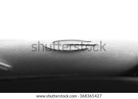 Close-up of a black button on the electronic device - stock photo
