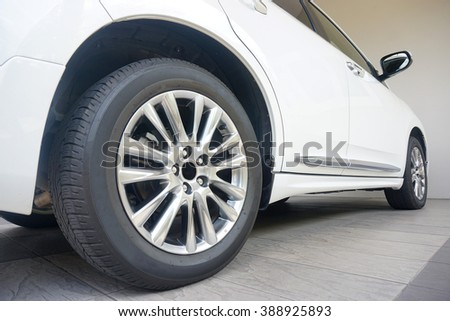 Close up of a black car tyre park at home - stock photo
