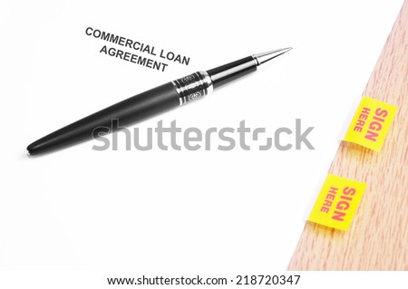 Close Up Of A Black Pen And Commercial Loan Agreement With Sign Here Stickers  - stock photo