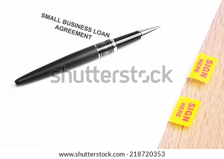 Close Up Of A Black Pen And Small Business Loan Agreement With Sign Here Stickers  - stock photo