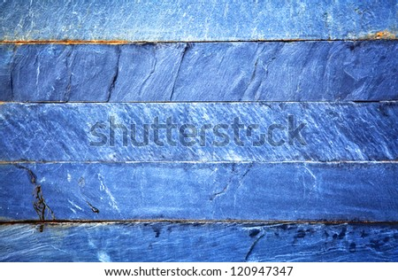 Close up of a blue brick-wall, texture background. Pattern of cracked real stone wall surface with cement - stock photo