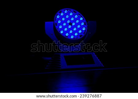 Close up of a blue scene spotlight - stock photo