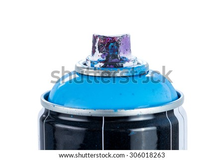 Close-up of a blue spray paint can with used and painty nozzle, isolated on white background. - stock photo