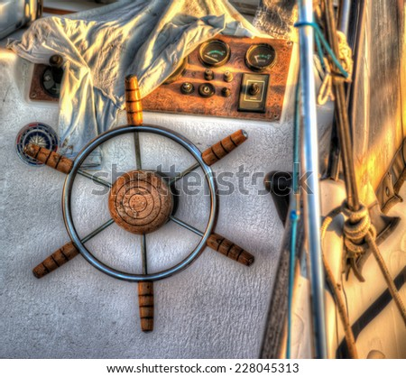 close up of a boat steering wheel. Heavy processed for hdr tone mapping effect. - stock photo