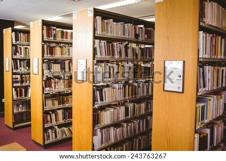 Close up of a bookshelf in library - stock photo