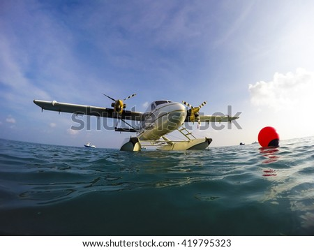 close up of a bow of a luxury sea plane parked at sea - stock photo
