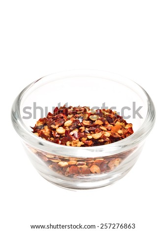 close up of a bowl of dried red chili flake isolate - stock photo