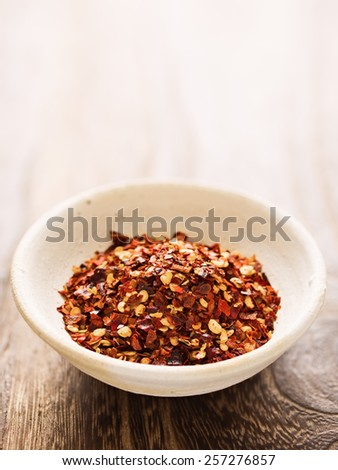 close up of a bowl of rustic dried red chili flake - stock photo