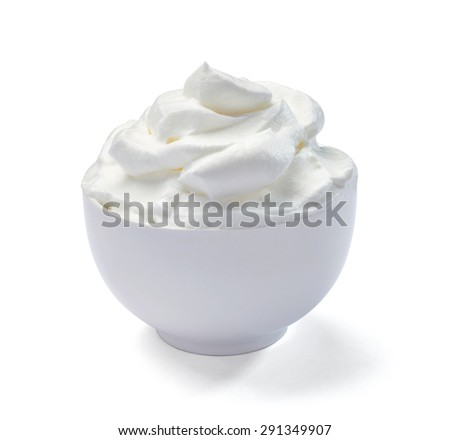 close up of a bowl with sour cream on white background - stock photo