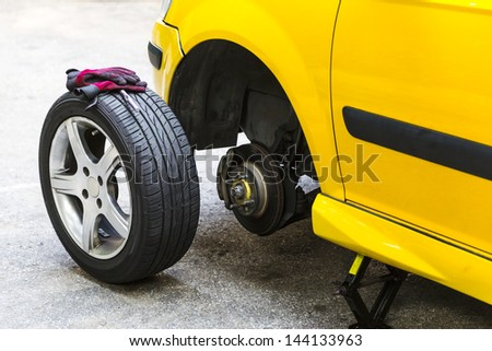 Close up of a breakdown car in the process of repairing. - stock photo