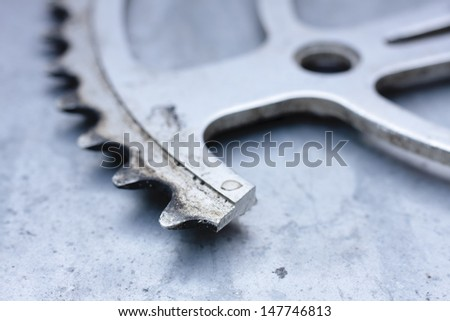 Close-up of a broken chainwheel from a bicycle - stock photo