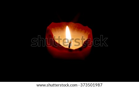 Close up of a burning candle / Candle light - stock photo