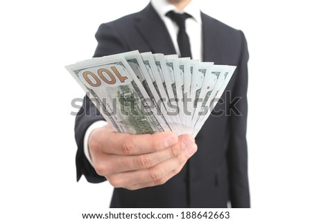 Close up of a business man hand holding money isolated on a white background           - stock photo