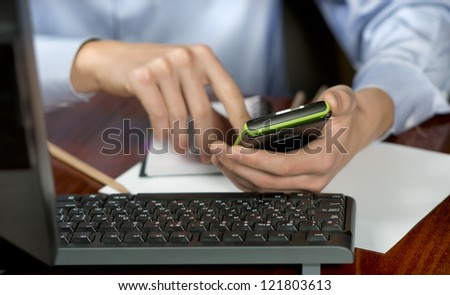 Close-up of a businessman in office with calculator, employee of the company makes a financial report, the math - stock photo