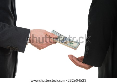 Close-up Of A Businessman Taking Bribe Over White Background - stock photo